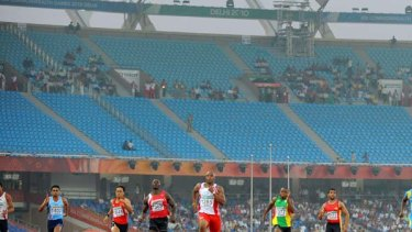 An almost empty stadium at the men's 100m qualification event.