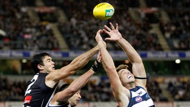 Aerial battle: Magpie Chris Tarrant spoils Cats James Podsiadly and Tom Hawkins.