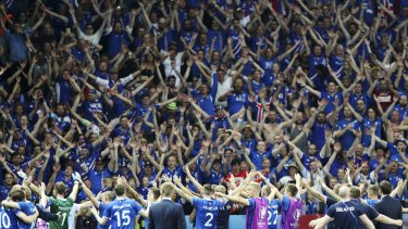 Iceland players celebrate their victory over England with the supporters in Nice last June.