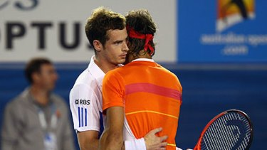 All over too soon ... Andy Murray embraces the injured Nadal after he retired in the third set of a brutal game.
