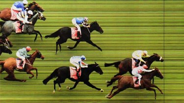 So close ... Dunaden just edges ahead of Red Cadeaux to win the 2011 Melbourne Cup.