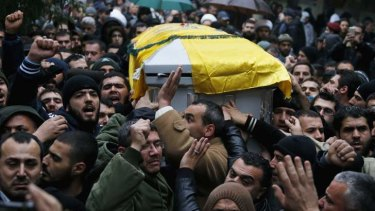 Outrage: Lebanon's Hezbollah members and relatives carry the coffin of Hassan al-Laqqis.