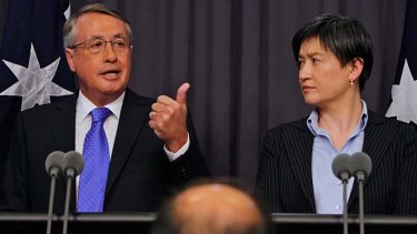 "Treasurer Wayne Swan and Finance Minister Penny Wong ... ""Since the big stimulus spending  Labor has put on the fiscal straitjacket, as it promised."""