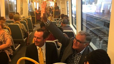 Dr Geoff Gallop on the train from Rockingham with Labor leader Mark McGowan.