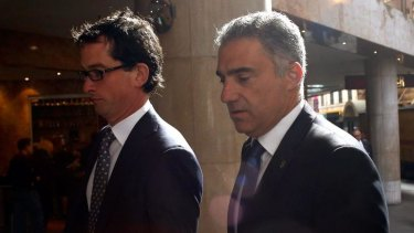 Paul Nicolaou, right, arrives at ICAC.