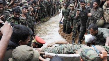 The body of the  Tamil Tigers leader Velupillai Prabhakaran (above), children in a refugee camp (bottom left) and Slumdog Millionaire child actor Rubina Ali Qureshi.