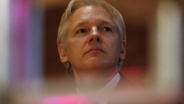 Julian Assange urged  Kevin Rudd to denounce  the bugging of the Ecuadorean embassy.