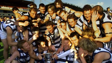 Dynasty created: Geelong celebrate their win over Port Melbourne in the 2002 VFL grand final. Cats players took pay cuts to keep their great team together.