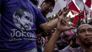 Jokowi supporters celebrate.