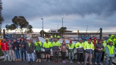 Workers picket the entrance to a Woolworths liquor distribution centre at Laverton.