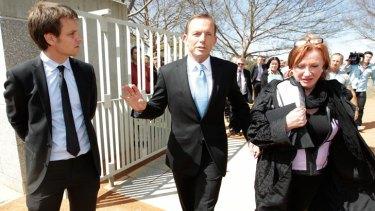 Craig Reucassel attempts to interview Opposition Leader Tony Abbott at the Bali Memorial Garden where he met with Clair Marsh, in Canberra on Thursday 20 September 2012. Photo: Alex Ellinghausen