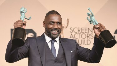 Idris Elba, winner of Outstanding Performance by a Male Actor in a Supporting Role for <i>Beasts of No Nation</i>, and Outstanding Performance by a Male Actor in a Television Movie or Miniseries for <i>Luther</i>.