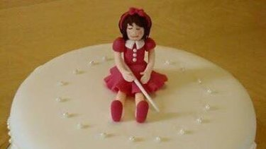 """Laura Seggie's birthday cake - decorated with a """"blind girl"""" instead of a """"blonde girl"""" thanks to autocorrect."""