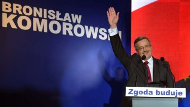 Presidential candidate Bronislaw Komorowski greets supporters in Warsaw.
