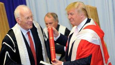 Sir Ian Wood, chancellor of Robert Gordon University, left, presents Donald Trump with his honorary degree.