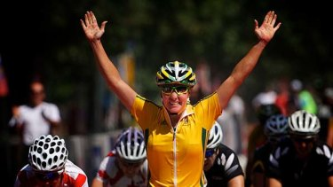 Road to success ... Rochelle Gilmore takes gold in the women's road race in Delhi yesterday. Fellow Australian Chloe Hosking picked up bronze.