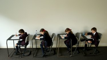 Students sit Naplan tests.