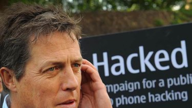British actor Hugh Grant outside the Houses of Parliament in London, where a debate was being held into the allegations of phone hacking by journalists.