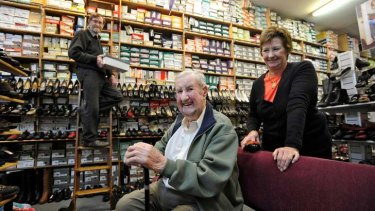 Eric Hicks (centre) with his children Murray and Julie in the store.