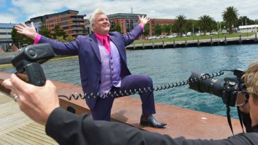 Darryn Lyons on the receiving end of paparazzi attention.
