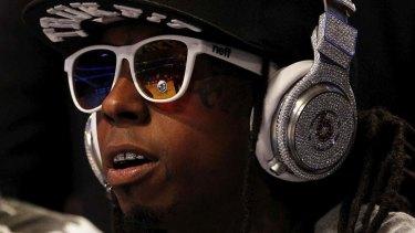 Rapper Lil' Wayne wears diamond-studded beats headphones.