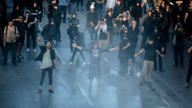 Protesters gesture during a protest against the G-20 summit in Hamburg, northern Germany, Thursday, July 6, 2017. The leaders of the group of 20 meet July 7 and 8. (AP Photo/Markus Schreiber)