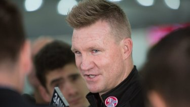 Pies coach Nathan Buckley with the Holden logo on his shirt.