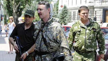 """Self-proclaimed minister of defence of the so-called """"Donetsk People's Republic"""" Igor Girkin, centre, walks with his bodyguards in the eastern Ukrainian city of Donetsk earlier this month."""