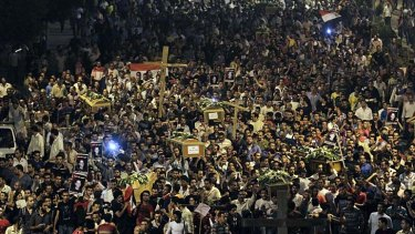 Grief and anger … Egyptian Copts carry the coffins of victims who were killed during clashes with military forces. Mourners called out: ''Oh, martyrs, sleep and rest, we will continue the struggle.''