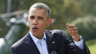 US President Barack Obama gestures as he speaks to the media on the situation in Iraq on the South Lawn of the White House.