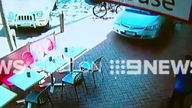 Shocking CCTV footage has captured the moment an elderly driver lost control of his car, ploughed down a busy shopping strip, and crashed into a building in Melbourne's south-east.