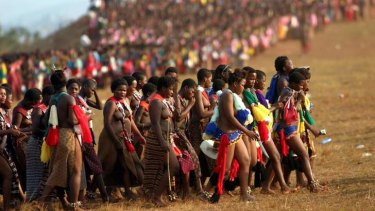 Pick me: Thousands of young girls gathered at the annual reed dance in Ludzidzini, Swaziland, in 2005. The annual ritual gives King Mswati  III an opportunity to choose another wife. His latest choice is  an 18-year-old beauty contestant.