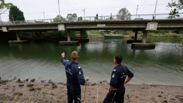 Police divers search for body parts.