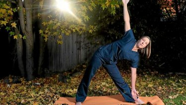 Intensive care nurse Sam Breguet practises yoga in her Geelong backyard. She says patients' health is jeopardised by fatigue among nursing staff.