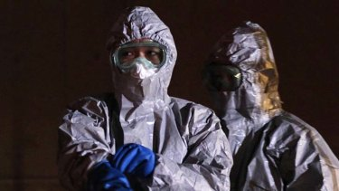 Officials in protective gear ear the Fukushima Daini nuclear plant, in Koriyama.