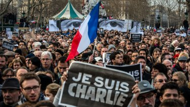 Thousands gather in Paris for a solidarity march with victims of the Charlie Hebdo massacre. The attack has sparked new calls to bolster the right to free speech in Australia.