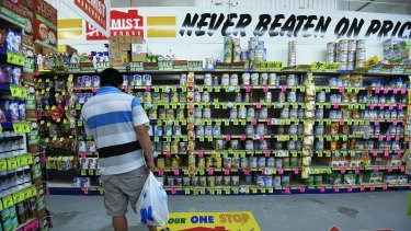 A man looks in the baby formula section of Chemist Warehouse in Campsie.