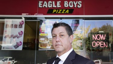 Business consultant Alan Noor poses outside Eagle Boys Pizza in Ryde. Mr Noor is suing the company after it sent an email allegedly defaming him to all its franchisees.
