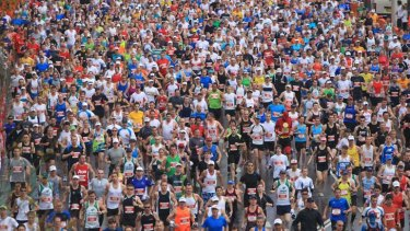 Mass attraction ... running in the rain at the City2Surf.