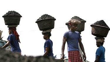 Carrying coal in Gauhati, India. An energy supply shortage could compromise plans to expand the economy and cut poverty.