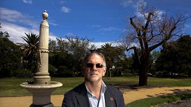 Historian Garrie Hutchinson in front of the Charles Moore Boer War memorial in Albert Park. Charlie Moore, who played 30 games for Essendon, was the first VFL player killed in war.