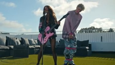 """Rapper Machine Gun Kelly thinks Megan Fox has the """"most beautiful feet"""" after she stepped on his face in his 'Bloody Valentine' music video."""