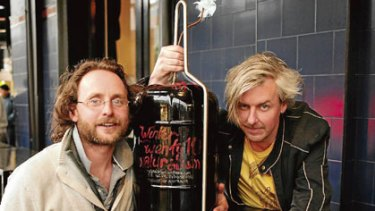 Tom Shobbrook left and Sam Hughes, with their Voice of the People, a 27-litre drum of wine with no additives. Olive oil floats on top to prevent oxidation as the level falls.  Photo: Marco Del Grande