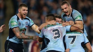 Joyous: NSW Blues celebrate after Hodkinson's match-winning play.