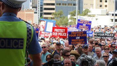 Officers and members of the public rally at Parliament House in support of police on the front line.