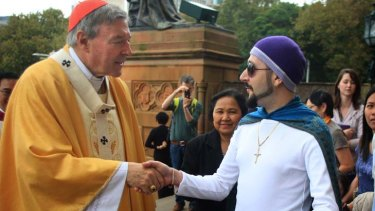 Meet the congregation ... Cardinal George Pell greets Con Ditsas outside St Mary's Cathedral after Easter Sunday morning Mass.
