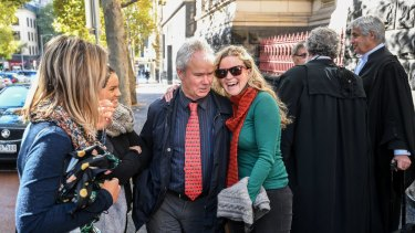 Art dealer Peter Gant and supporters leave the Court of Appeal.
