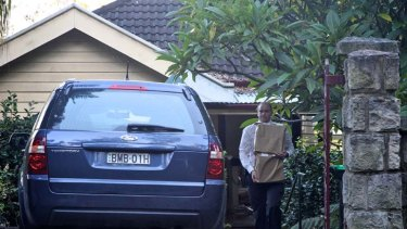 Search ... police raided the Palm Beach home of John Gilleland.