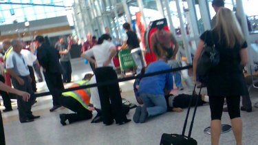 Airport staff  and members of the public try to revive Anthony Zervas.