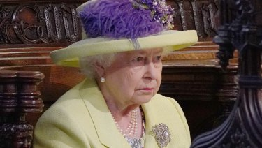 One is not amused: Queen Elizabeth II listens to Michael Curry.
